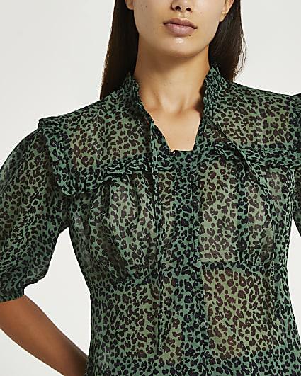 Green animal print tie neck blouse