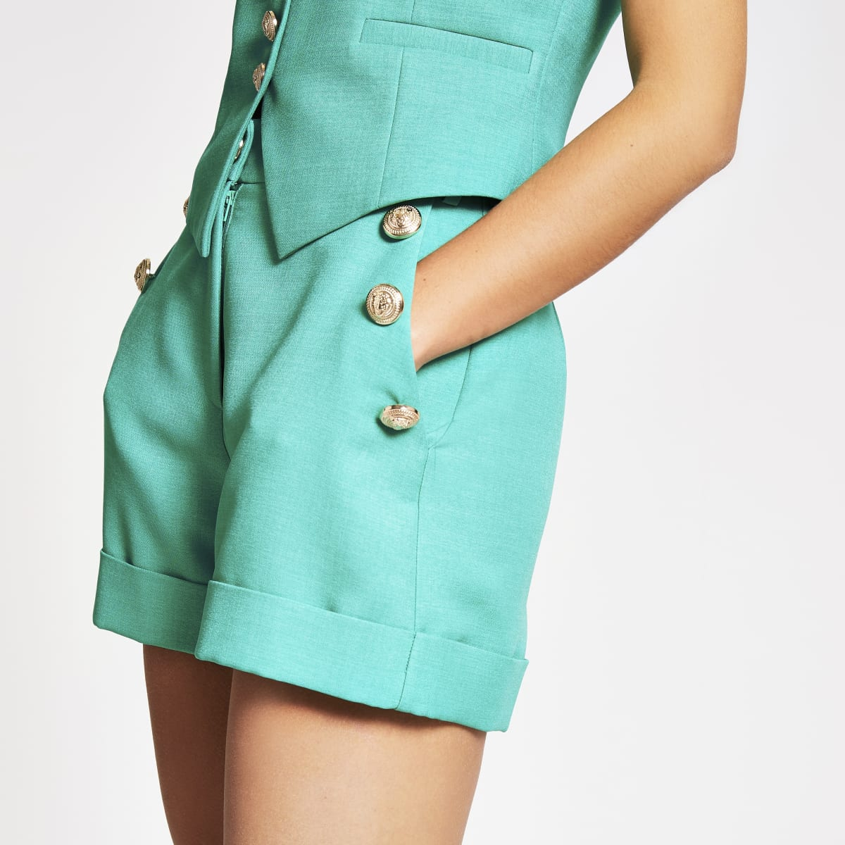Green button front high rise shorts