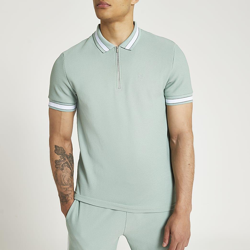 Green colour block zip textured polo shirt