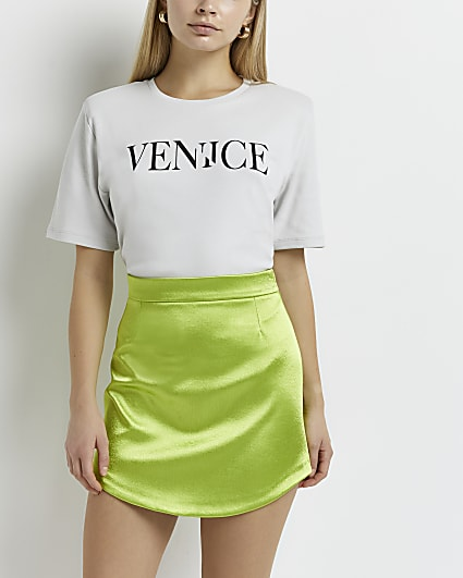 Green curved hem mini skirt