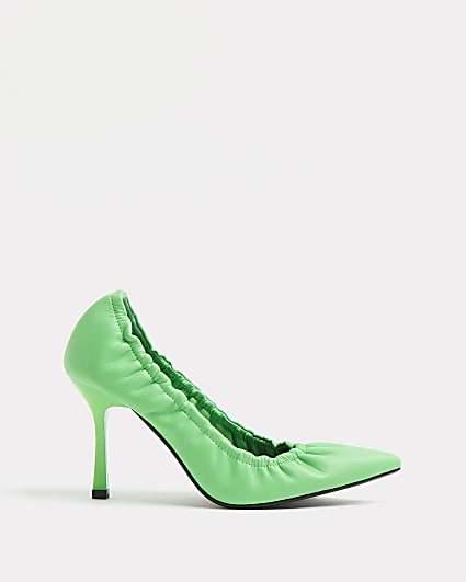 Green elasticated court shoes