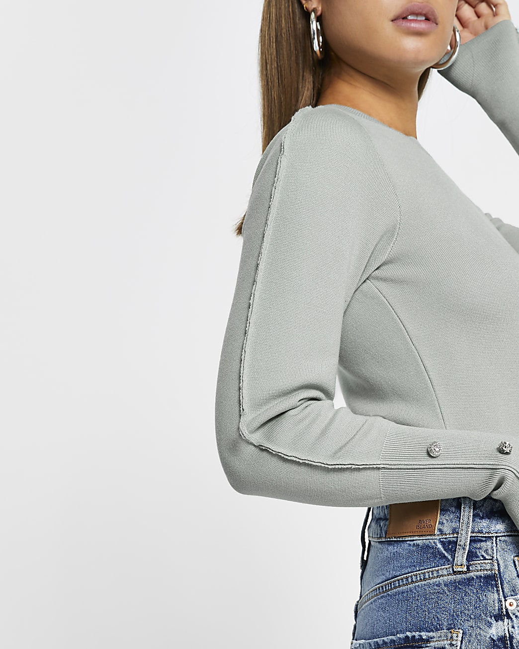 Green embellished long sleeve knit top