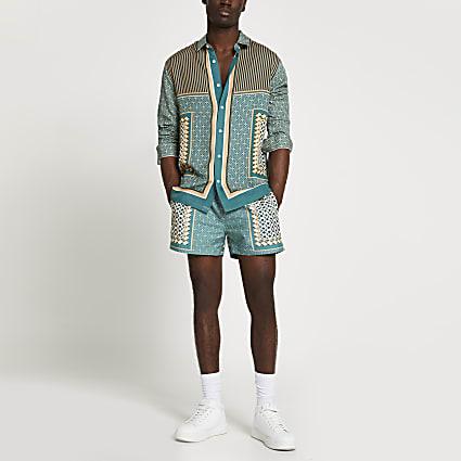 Green geo print swim shorts