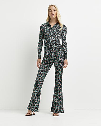 Green geometric print flared trousers