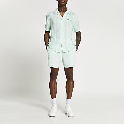 Green graphic print swim shorts