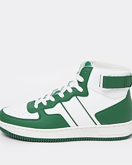 Green high top court trainers