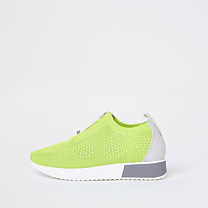 Green knitted runner trainers