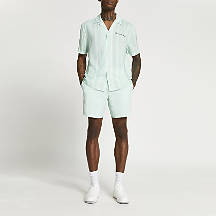 Green 'Les Ensemble' swim shorts