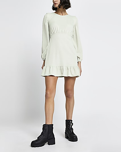Green long sleeve frill hem mini dress