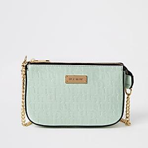 Grüne Handtasche aus Lack mit RI-Verzierung