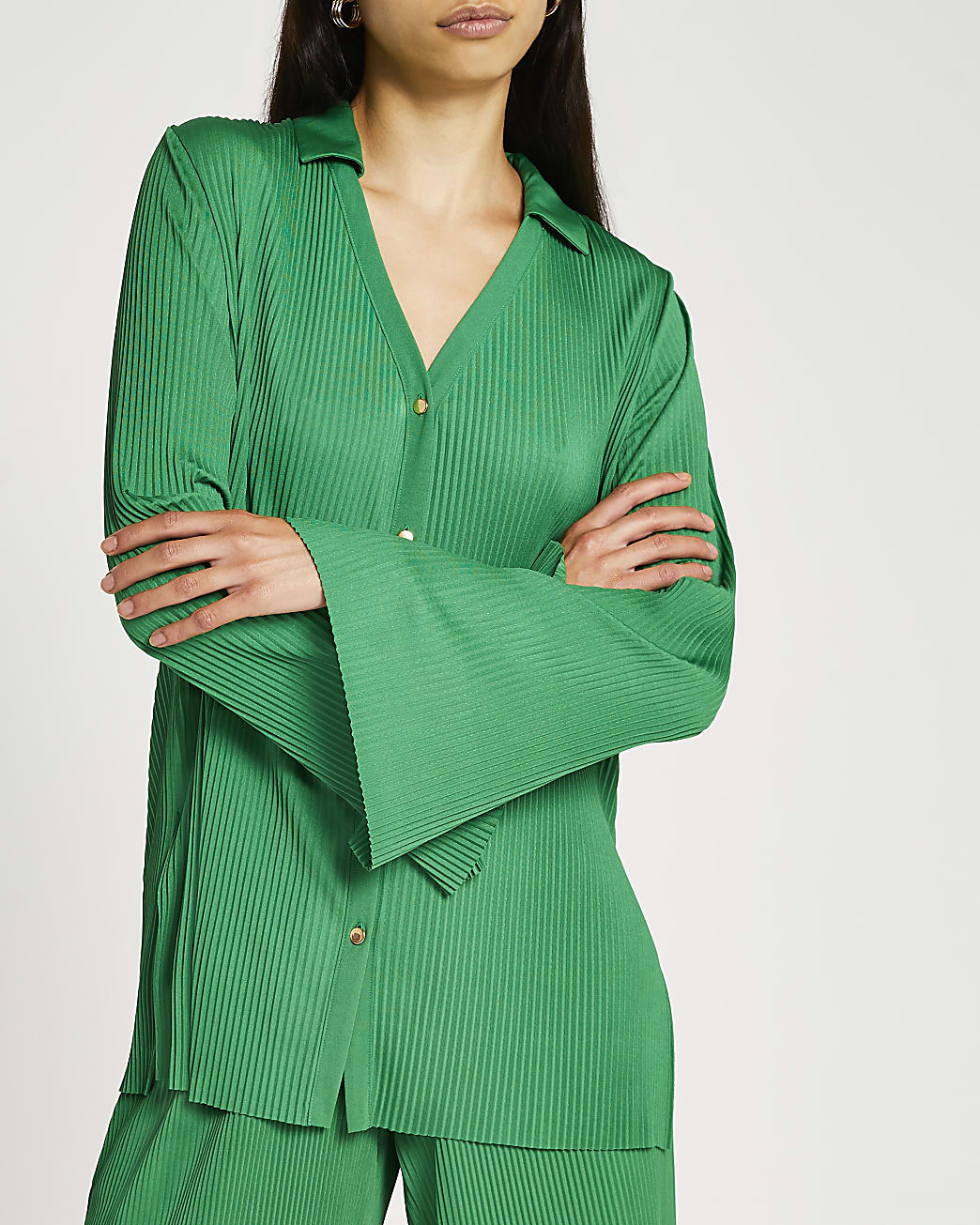Green pleated shirt