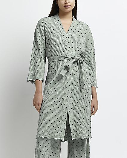 Green polka dot robe