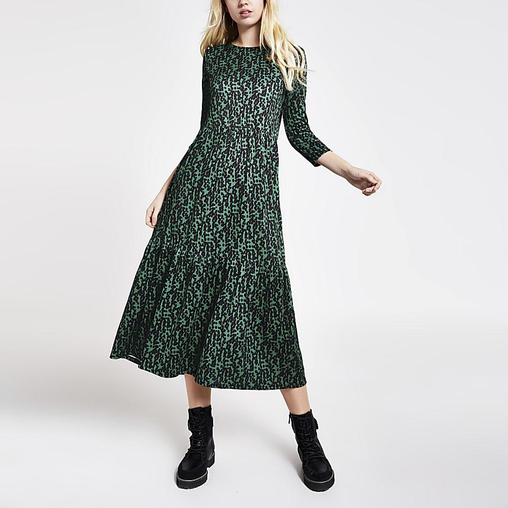 Robe midi à smocks et manches longues imprimée verte