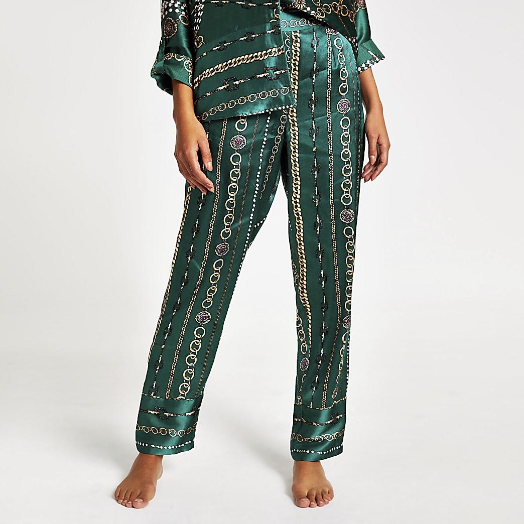 Groene satijnen familie pyjamabroek met print