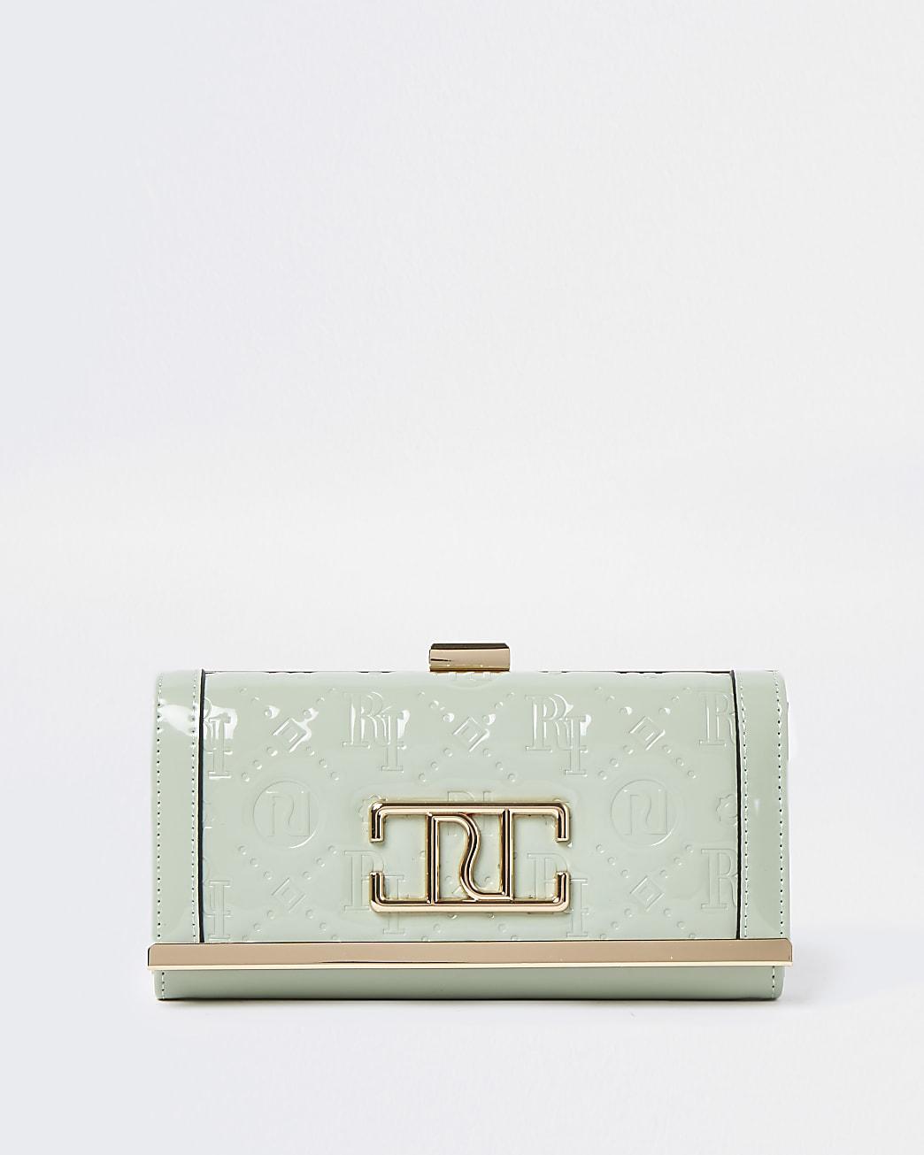Green RI embossed patent cliptop purse
