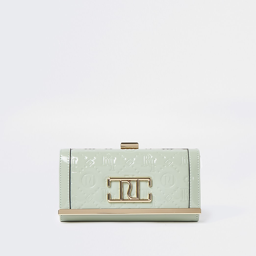 Green RI embossed patent cliptop purse