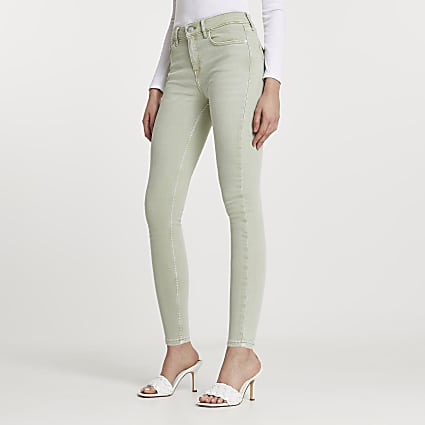 Green skinny mid rise jeans