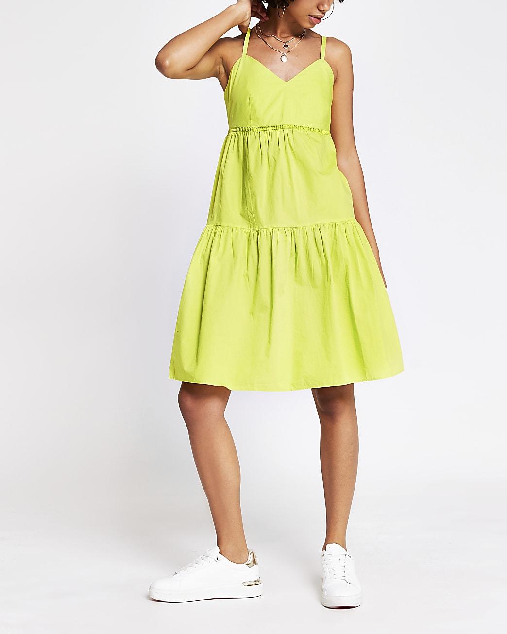 Green sleeveless ladder trim smock dress