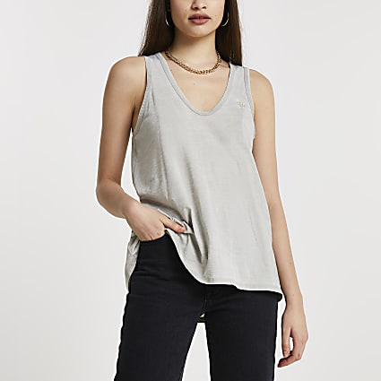 Green sleeveless v neck vest top