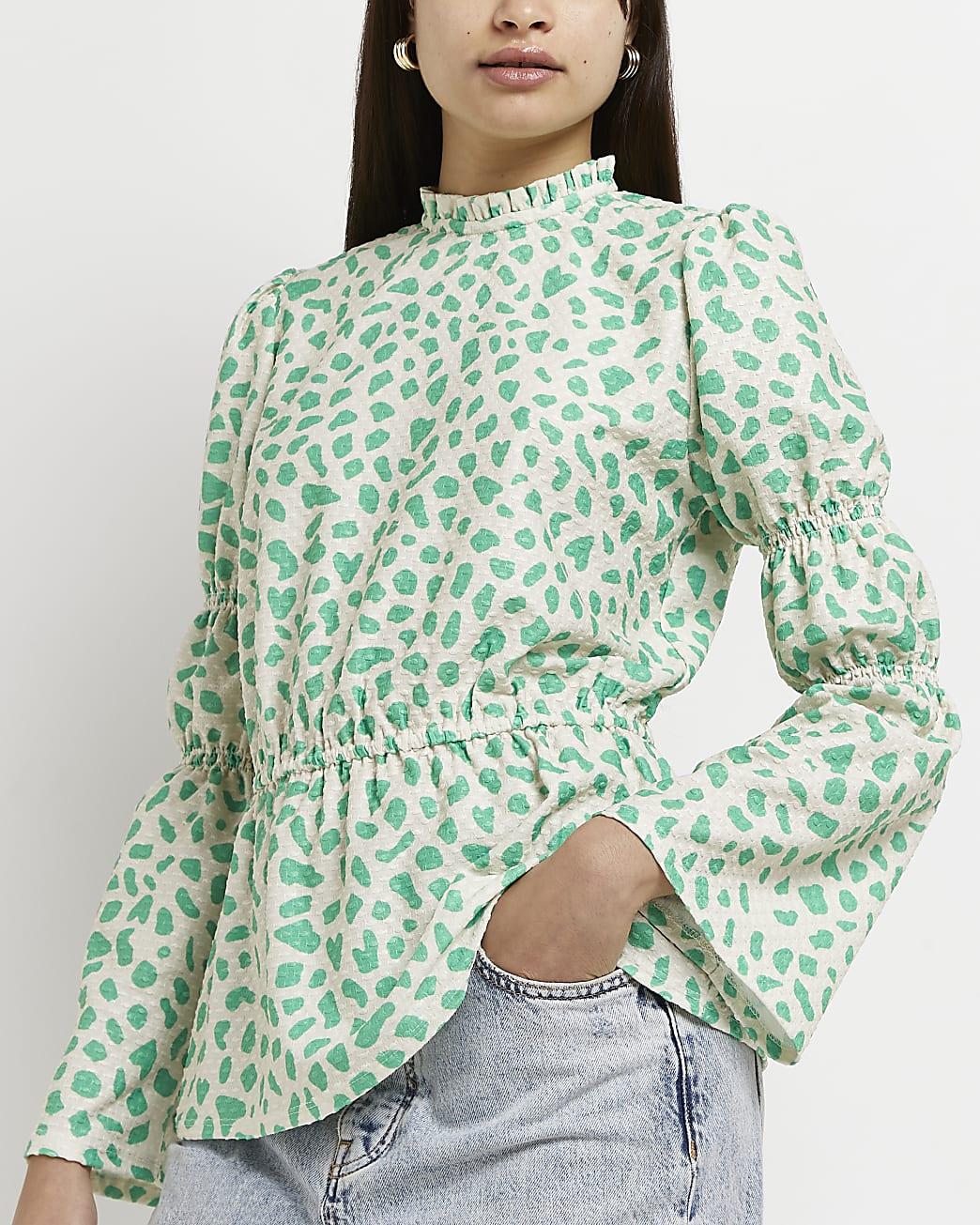 Green spot print peplum hem blouse