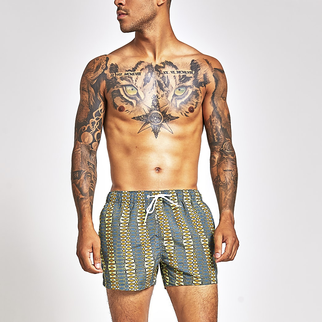 Green stripe print swim shorts