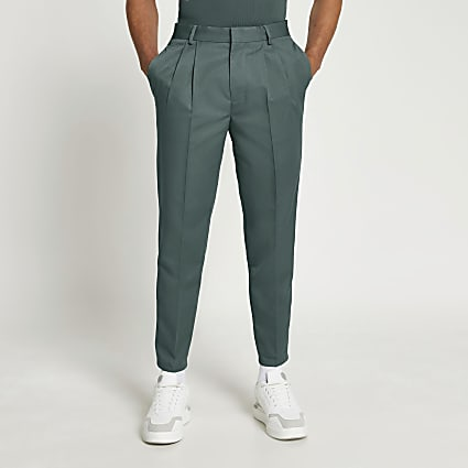 Green tapered pleat trousers
