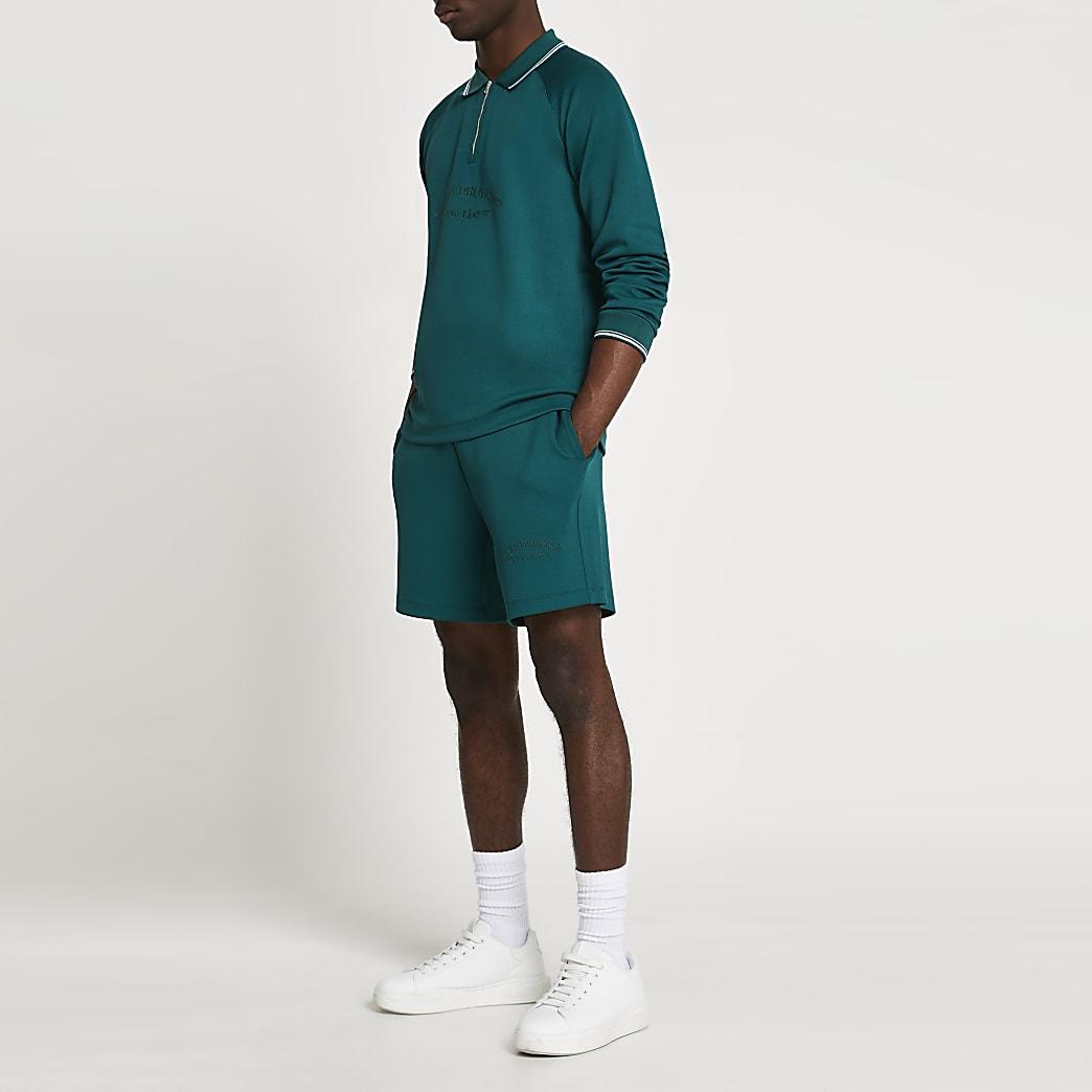 Green tropic tennis shorts