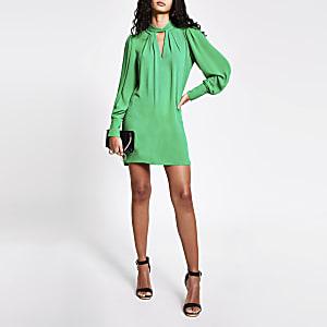 Green twisted cut out neck mini swing dress