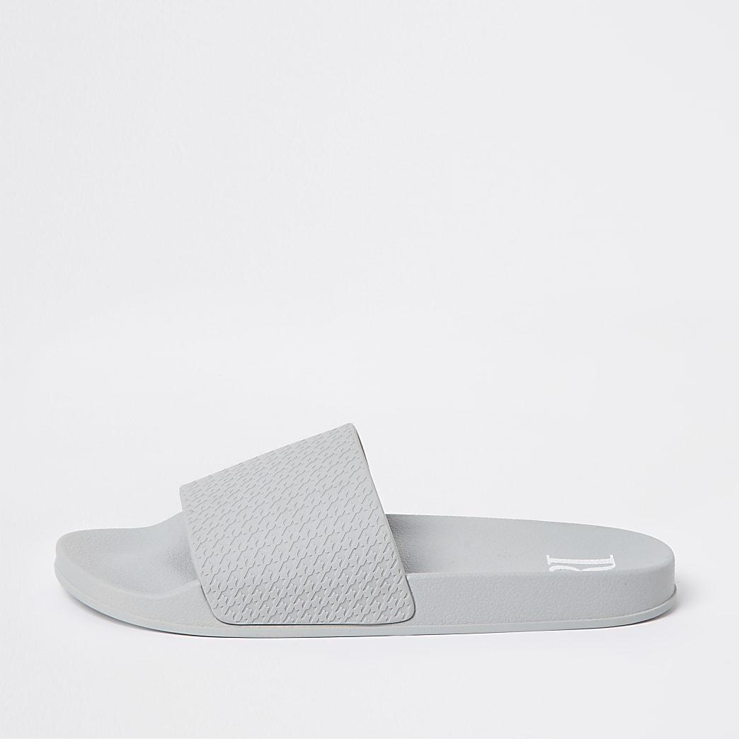 Grey dogtooth embossed sliders