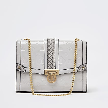 Grey embossed patent monogram bag