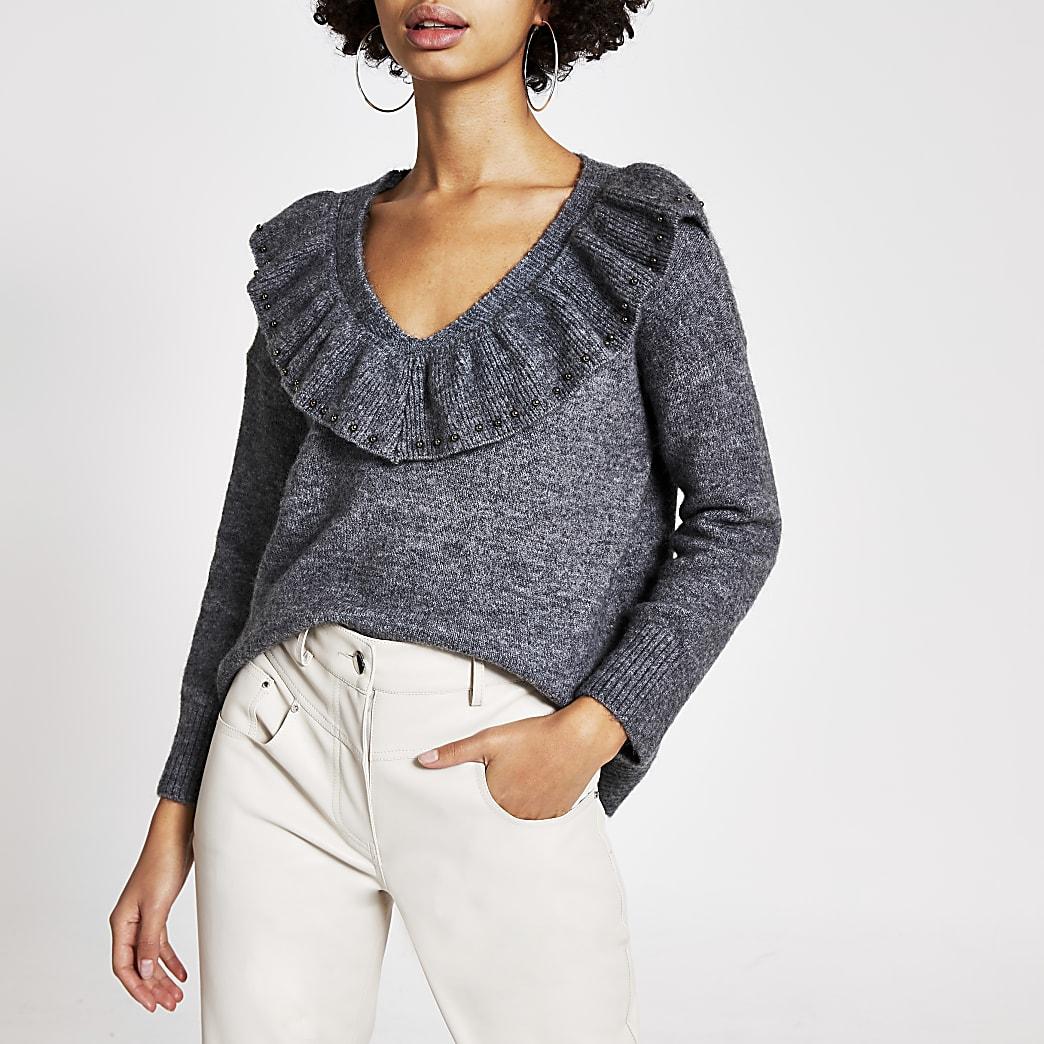 Grijze gebreide trui met franje en V-hals