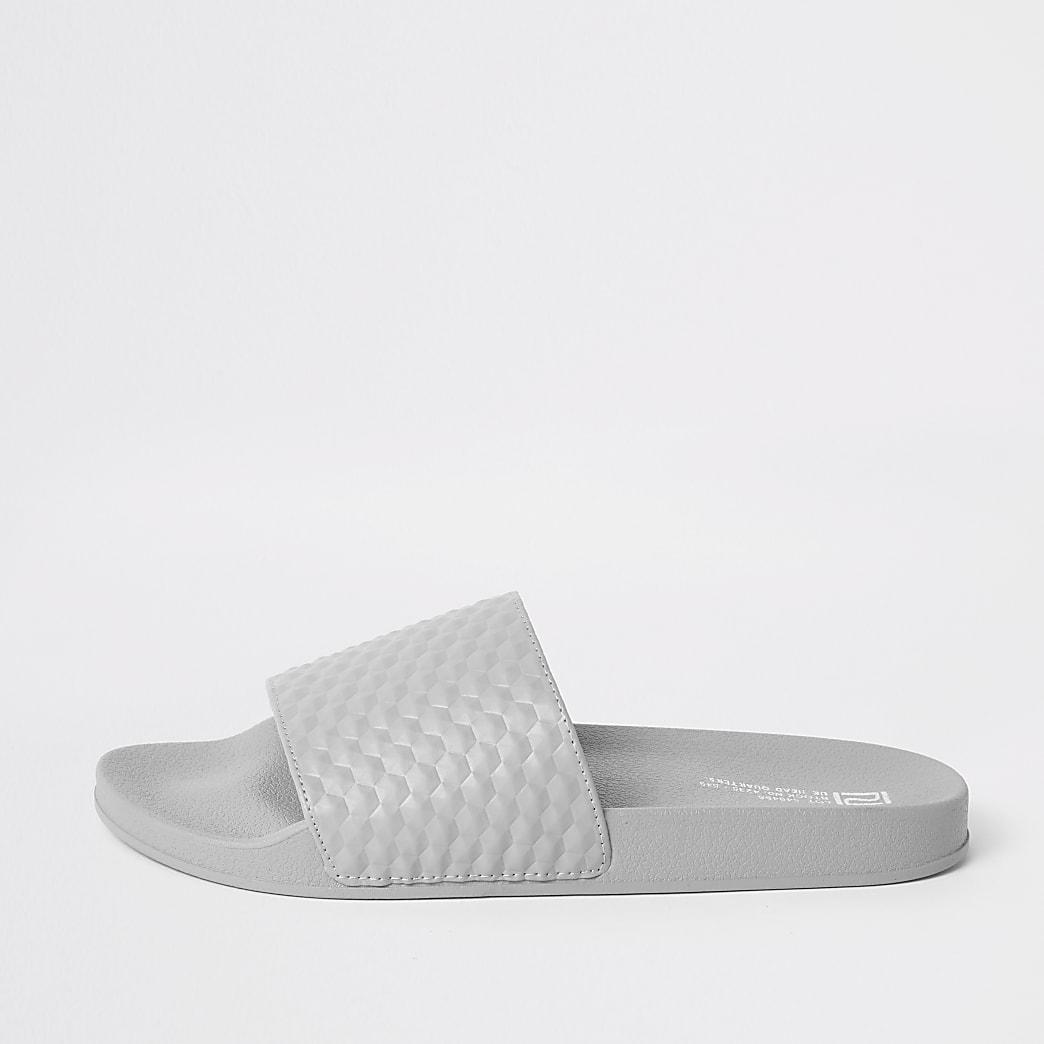 Grijze slippers met geometrische textuur