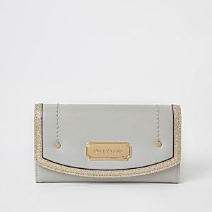 Grijze  opvouwbare portemonnee afgezet metglitter