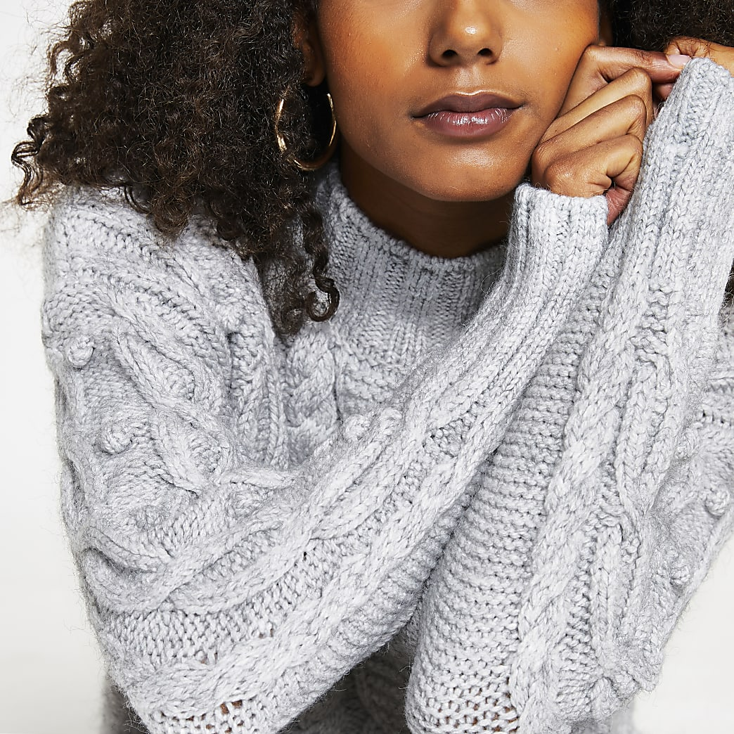 Grey long sleeve cable knit jumper