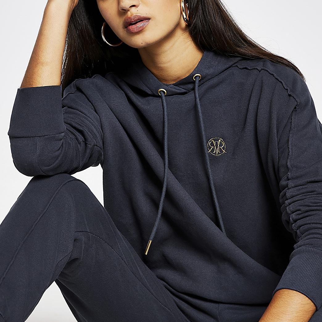 Grey long sleeve exposed seam hoody