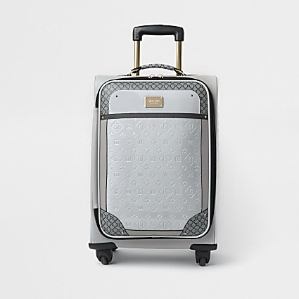 Grey patent monogram embossed suitcase
