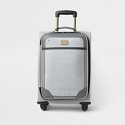 Grey patent monogram embossed suitcase