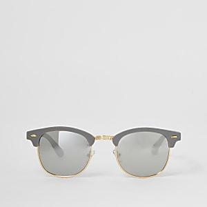 Grijze zonnebril met retro montuur