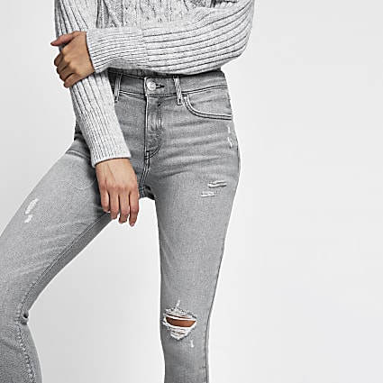Grey ripped mid rise skinny jeans
