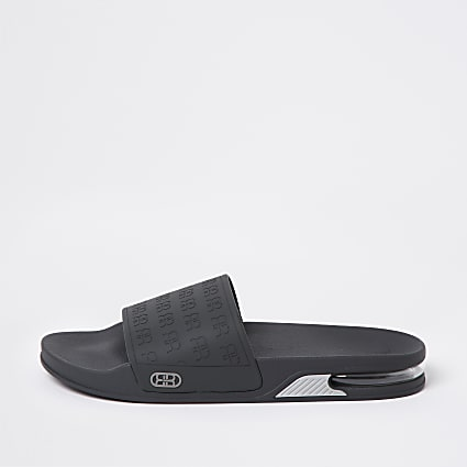 Grey RR monogram bubble sole sliders