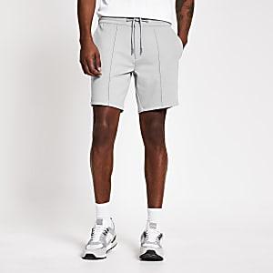 Grijze skinnySid shorts van jersey stof