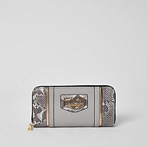 Grijze portemonnee met rits rondom, slangenprint en kleurvlakken