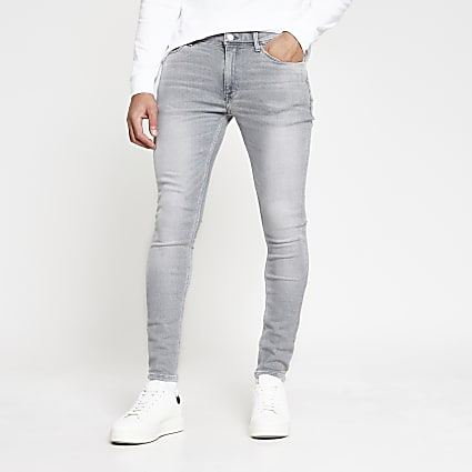 Grey spray on denim jeans