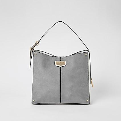 Grey suedette padlock side slouch handbag