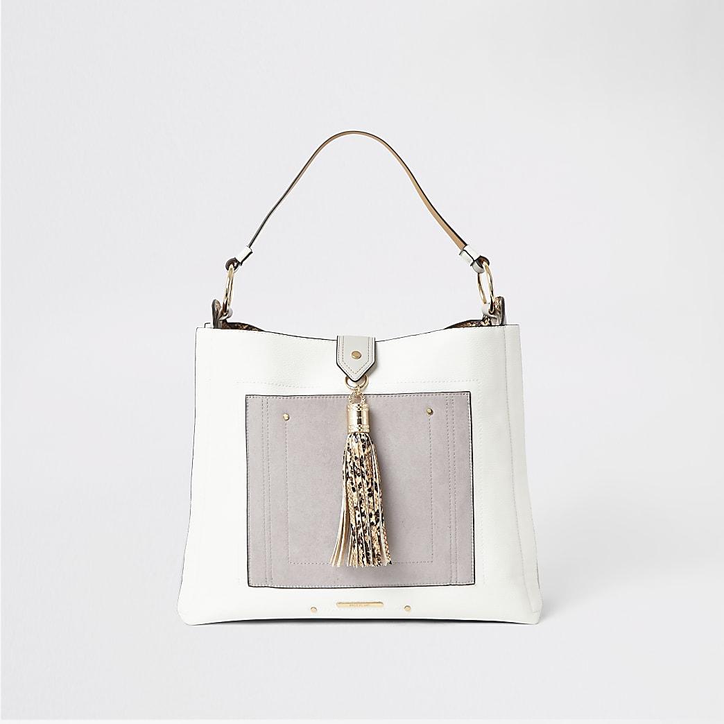 Grey tassel and pocket front slouch bag