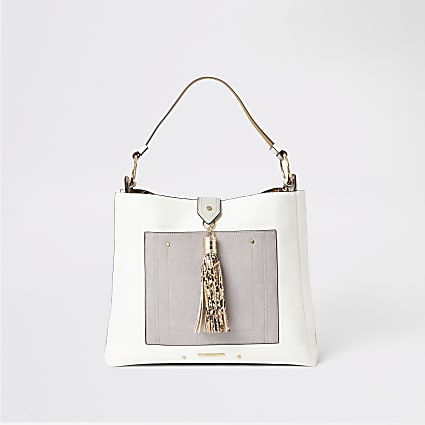 Grey tassel and pocket front slouch handbag