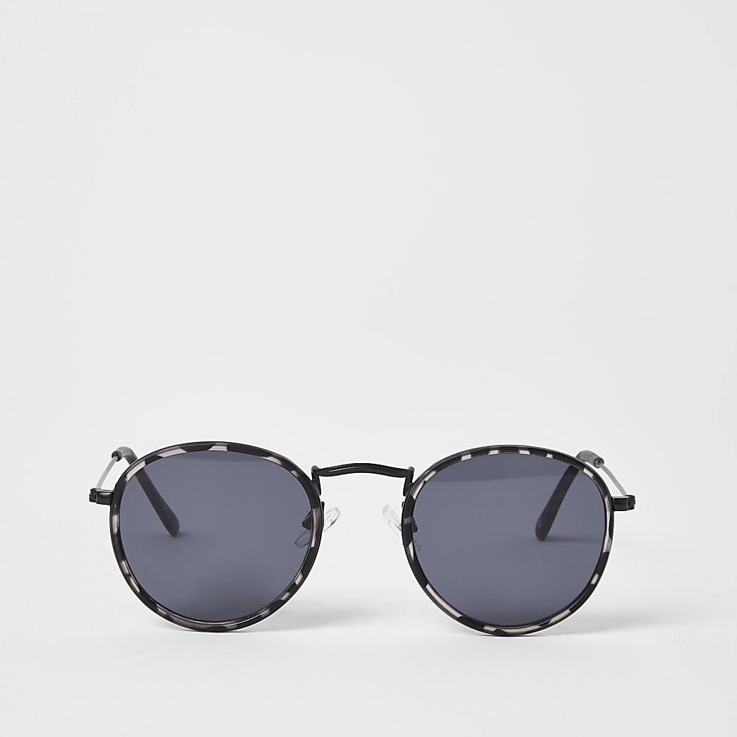 Grey tortoise shell round sunglasses