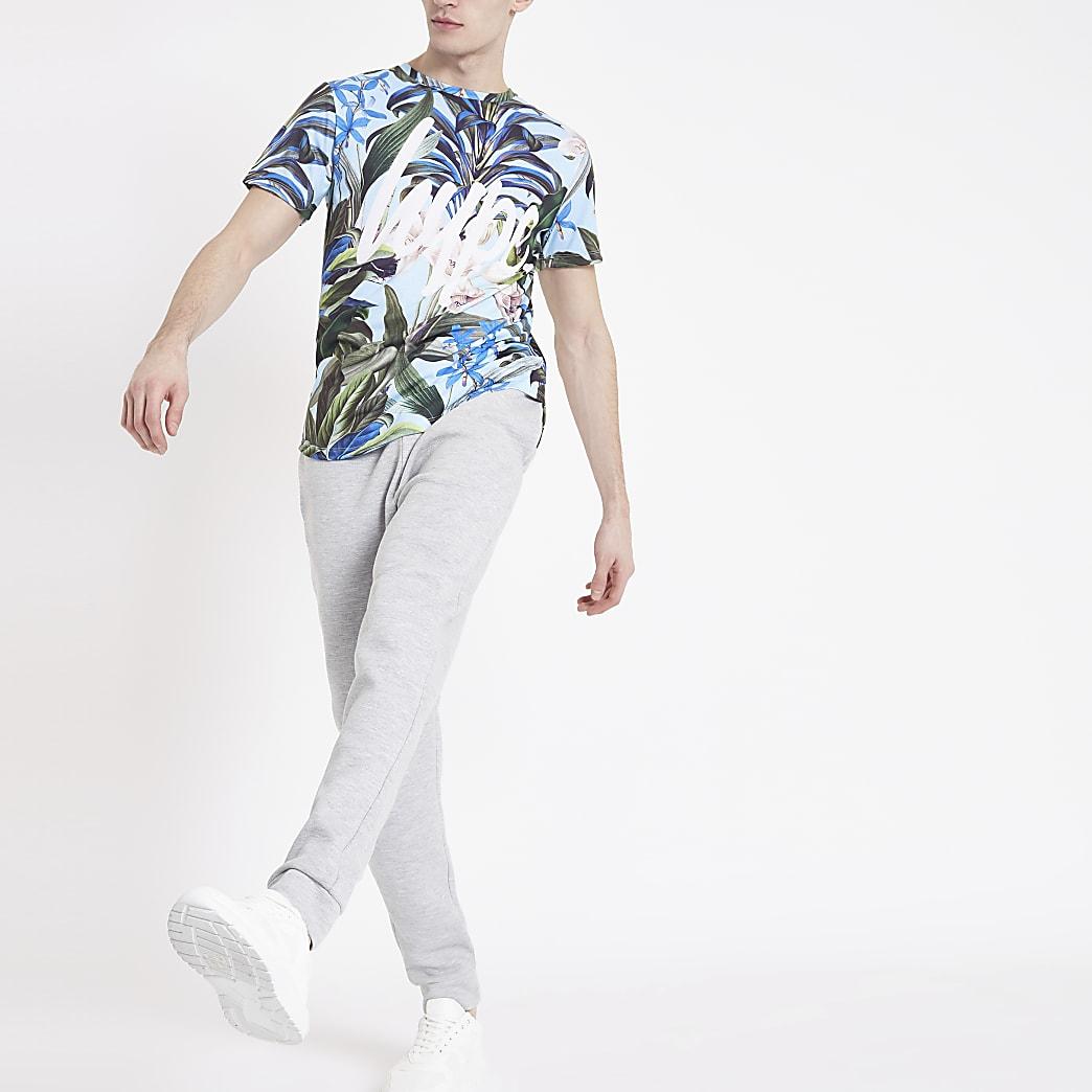 Hype - Blauw T-shirt met tropische print en ronde zoom