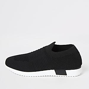 Schwarze Sneakers