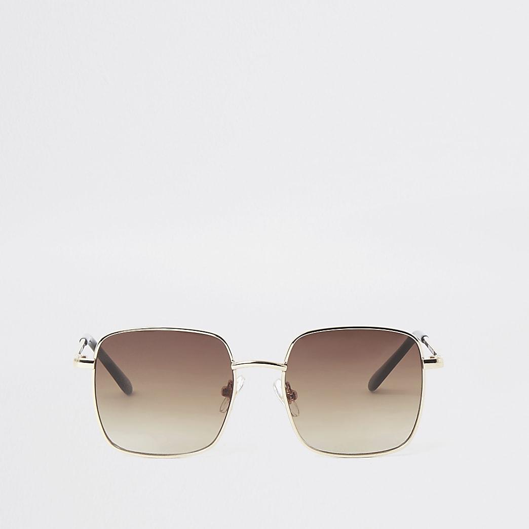 Goudkleurige kinderzonnebril met getinte glazen